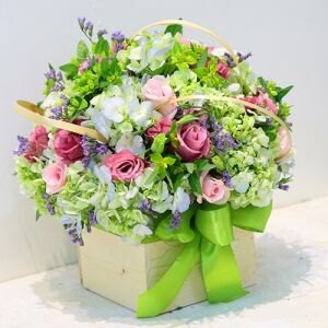 Mixed bouquet in container